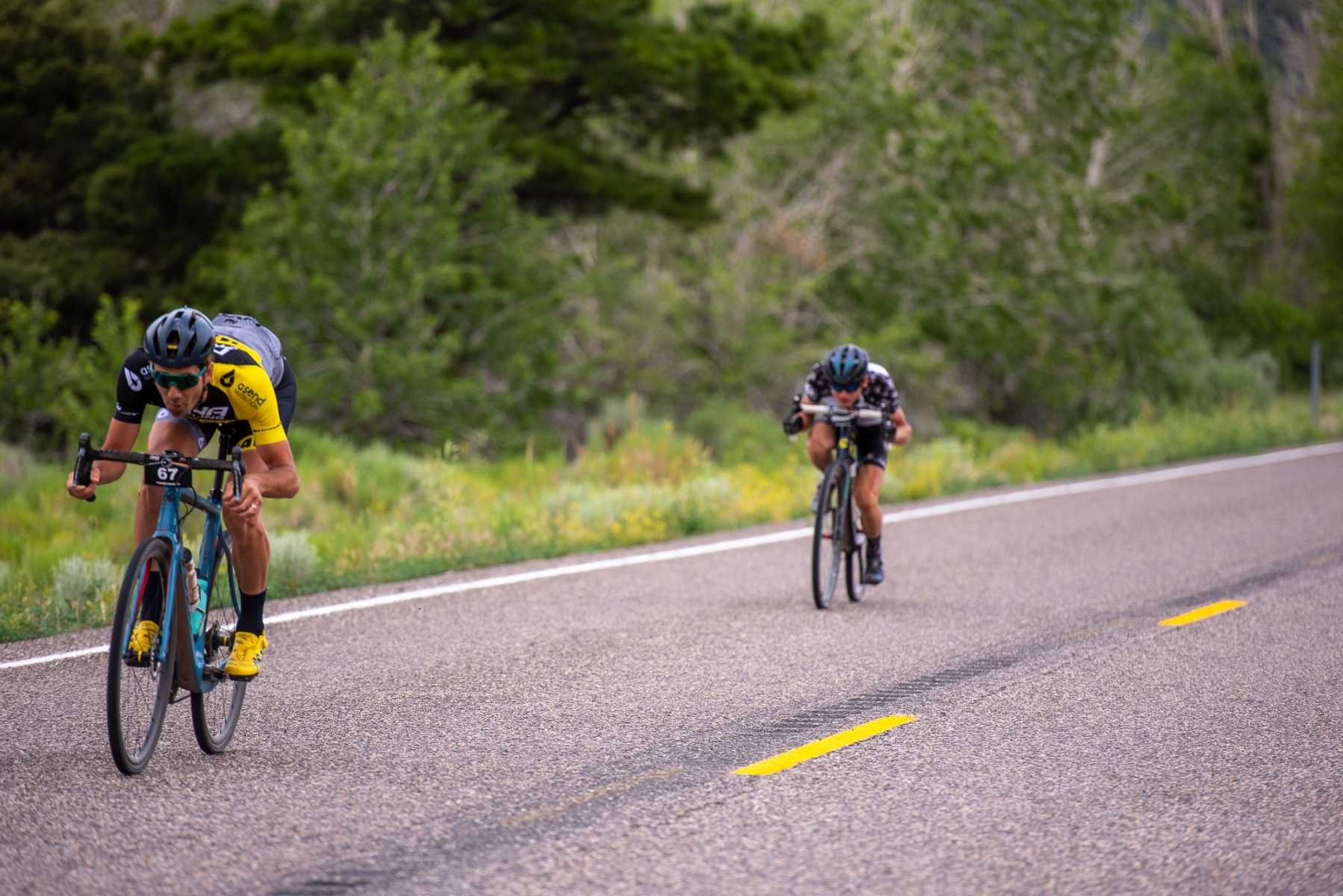 Jamey Driscoll (DNA Cycling-Mavic) leads Alex Grant (Gear Rush) down the Highway 153 descent. Photo: Steven L. Sheffield
