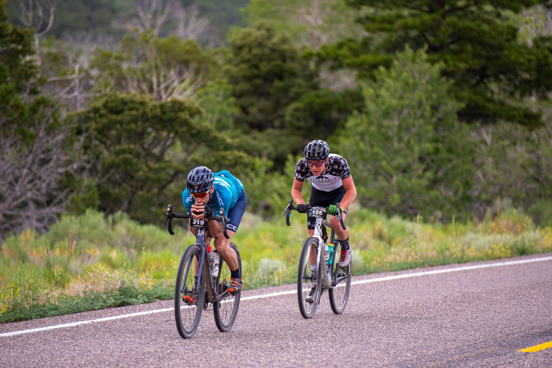 Erik Harrington (#319), leader of the Mens 40-44 group leads Matthew Turner, racing in the Pro/Open field, down the Highway 153 descent. Photo: Steven L. Sheffield.