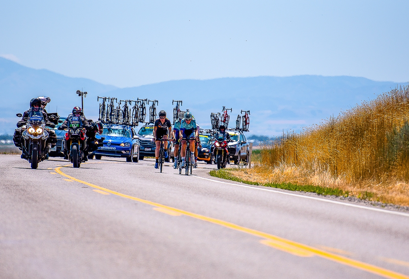 The early break on Utah State Road 23 outside Newton, Utah. Stage 1, 2019 Tour of Utah. Photo by Steven L. Sheffield