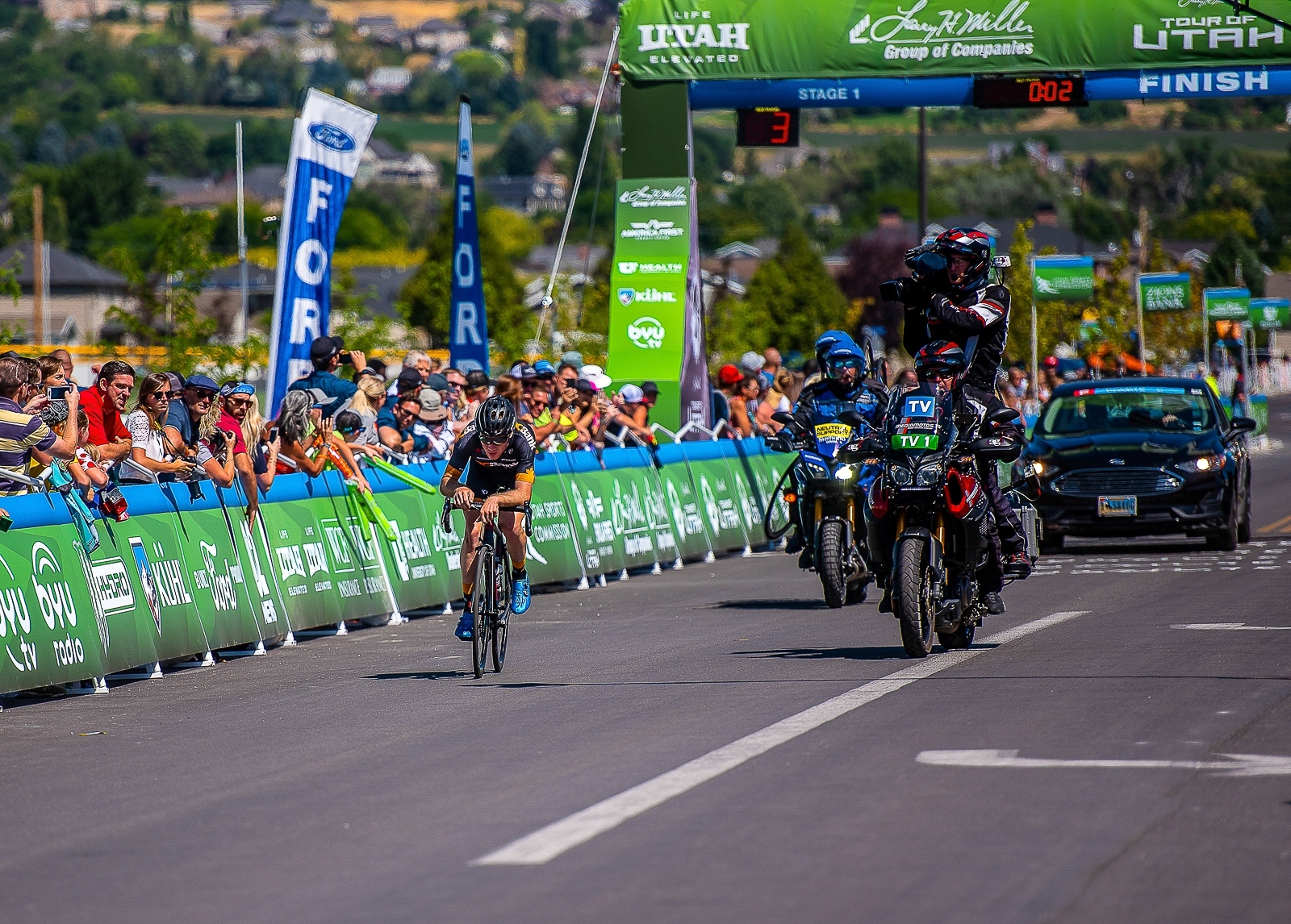 A DC Bank rider is solo off the front with 3 laps of the finishing circuit to go. Stage 1, 2019 Tour of Utah. Photo by Steven L. Sheffield