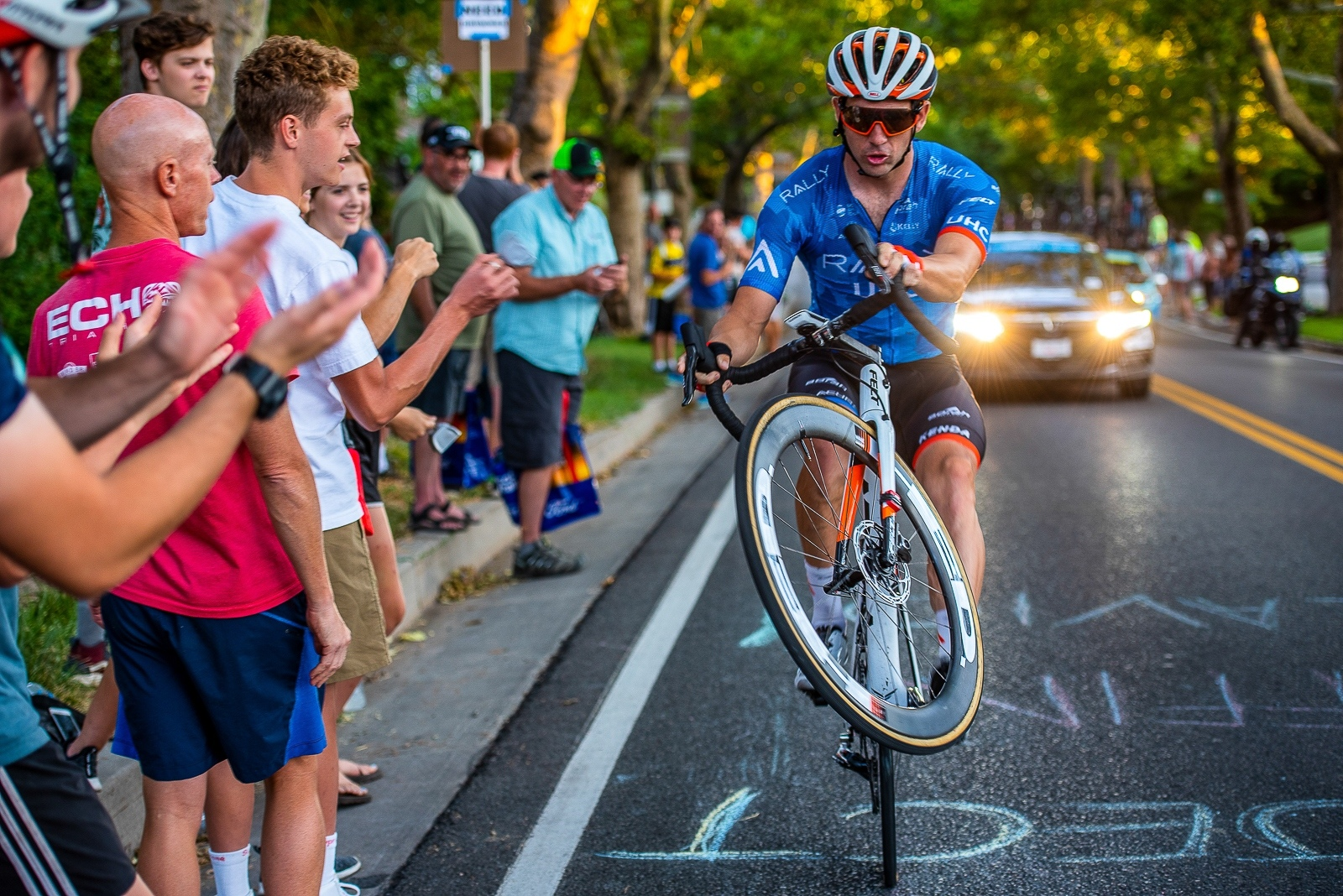 Ty Magner (Rally UHC Cycling) rides a wheelie up State Street. Stage 4, 2019 Tour of Utah. Photo by Steven L. Sheffield