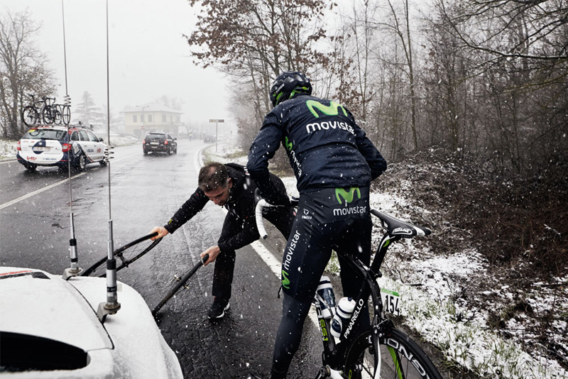 A fast wheel change in the snow at Milan-San Remo courtesy of Vittoria's neutral support crew. Photo by Taz Darling